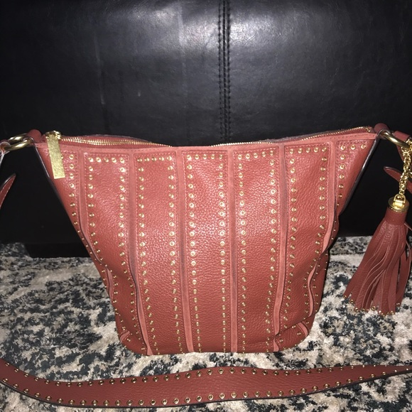 b8103e64256542 Michael Kors Bags | Brick Red Brooklyn Grommet Feed Bag | Poshmark